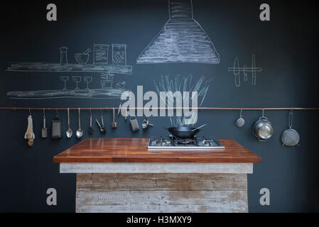 Kitchen with chalkboard wall background - Stock Image