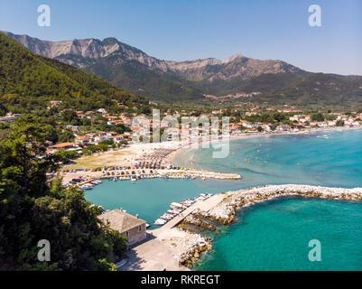 Golden Beach and Skala Potamia harbour in Thassos, Greece - Stock Image