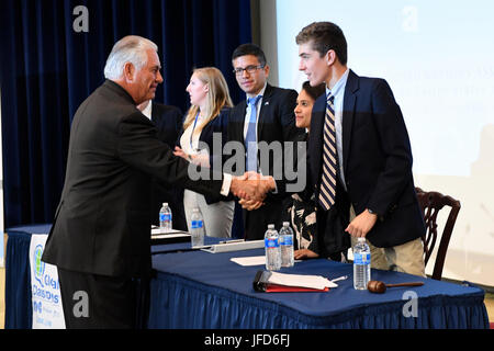 U.S. Secretary of State Rex Tillerson greets students participating in the Model United Nations Conference before - Stock Image