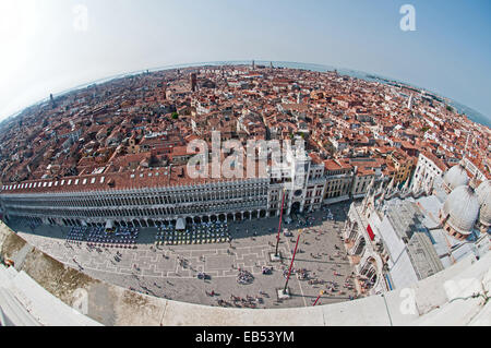 Fish eye lens view north west from St Marks Bell Tower Venice Italy showing Piazza San Marco with Clock Tower and - Stock Image