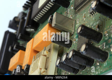 A closeup view of a very old circuit board inside an old internet modem - Stock Image