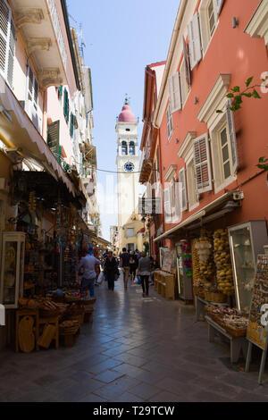 CORFU, GREECE - APRIL 7, 2018: Narrow streets of Kerkyra Town, Corfu island, Greece. Bell tower of the Saint Spyridon Church. - Stock Image