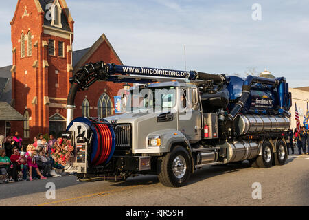 LINCOLNTON, NC, USA-11/25/18:  The city's Vacuum truck, used for sewage collection,  is driven in the local Christmas parade. - Stock Image