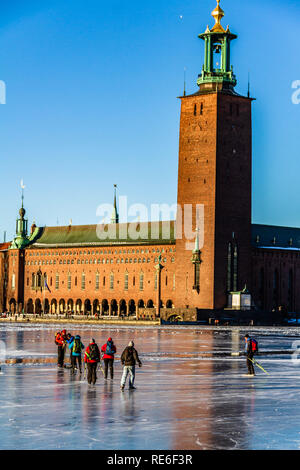 Ice skaters on frozen Lake Malaren in front of the City Hall, Stockholm, Sweden. 20th January, 2019. - Stock Image