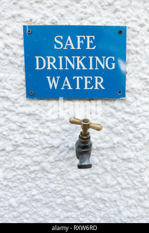 Safe Drinking Water tap and sign outside the Bridge of Orchy Hotel on the West Highland Way, Bridge of Orchy, Argyll, Scotland, UK - Stock Image