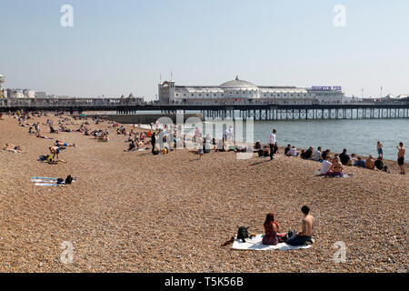 Easter Sunday on the beach at Brighton in East Sussex, England. Record Easter temperatures were recorded in England in 2019. - Stock Image