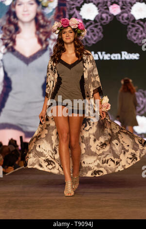 Montreal,Canada. A model walks on the runway at the La Vie en Rose fashion show held during the Fashion and Design Festival. - Stock Image