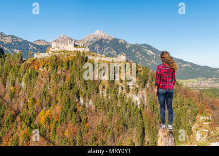 Reutte, Tyrol, Austria, Europe. Ehrenberg Castle and the Highline 179, the world's longest pedestrian suspension bridge. A young woman admiring the vi - Stock Image
