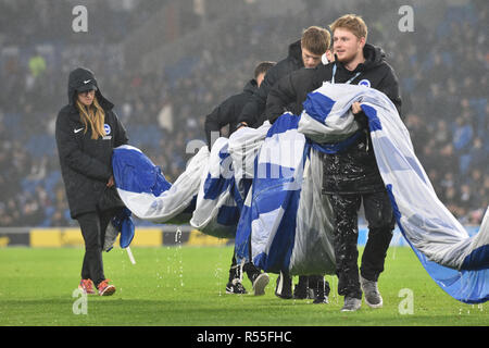 It's heavy work for the ground staff in the rain during the Premier League match between Brighton and Hove Albion and Leicester City at American Express Community Stadium , Brighton , 24 November 2018 - Stock Image