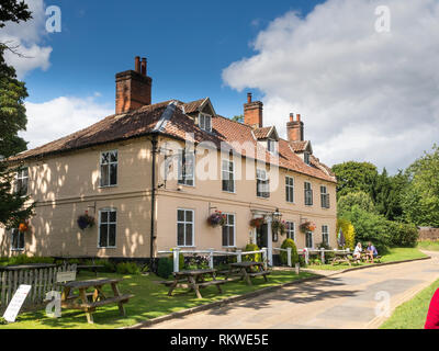 A couple sat outside the Bucks Arms at Blickling in Norfolk. - Stock Image