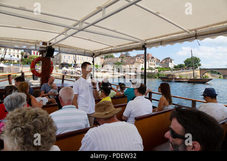 Bergerac tourism - tourists on a boat trip on a traditional Gabarre, Dordogne River at Bergerac, Dordogne France Europe - Stock Image