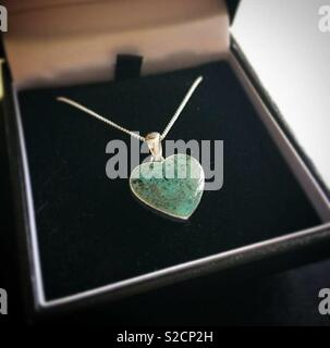 Handmade cremation ash necklace @ IsleofResin - Stock Image