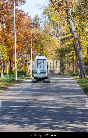 A special machine cleans the streets and rest parks from debris and dust.Ukraine, Kiev 20.10.2018 - Stock Image