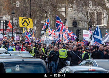 London, UK. 9 December 2018. Protesters march through central London for a pro-Brexit rally. The 'Brexit Betrayal' march is backed by UKIP leader Gerard Batten and Tommy Robinson (real name Stephen Yaxley-Lennon). Credit: Peter Manning Credit: Peter Manning/Alamy Live News - Stock Image