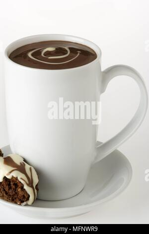 White porcelain cup with drinking chocolate. Almond and chocolate biscoti in saucer. Studio shot.      Ref: CRB538_103609_0014  COMPULSORY CREDIT: Mar - Stock Image