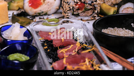 Close up view of an assortment of Japanese food: tuna sashimi - Stock Image