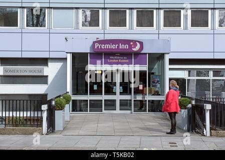 Premier Inn, London Euston with lady outside, England Britain UK - Stock Image