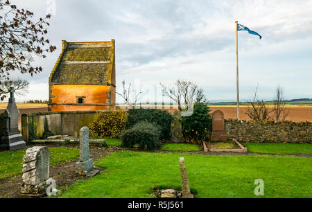 National Flag Heritage Centre saltire birthplace, Athelstaneford village, East Lothian, Scotland, UK with gravestones and historic dovecote - Stock Image