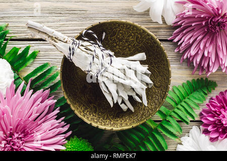 White Sage Bundle with Spring Flowers - Stock Image