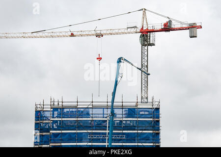 Gosford, New South Wales, Australia - September 3. 2018: Construction and building progress update 125. Pumping concrete on new home units building si - Stock Image