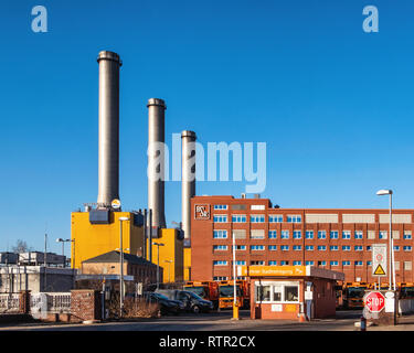 Berlin-Wilmersdorf. Utility companies. BSR City Cleaning Department and Vattenfall Co-generation power station Chimneys - Stock Image