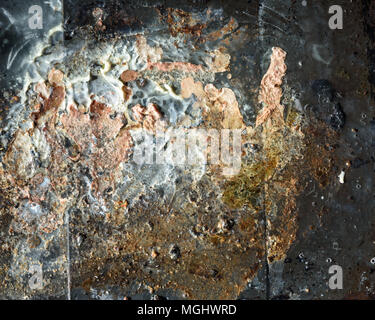 Overhead view of used saturated cooking grease and fat congealed with the water surface of a cooking tray found in domestic kitchens. Copy Space area  - Stock Image