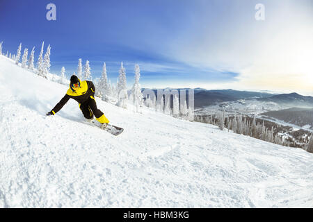 Snowboarder slope downhill mountains ski - Stock Image