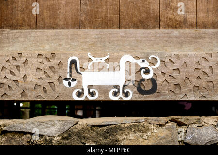 Painted and carved wood decorations on lower part of 'bhaga' (female ancestor shrines), Bena traditional village, Island of Flores, Indonesia. - Stock Image