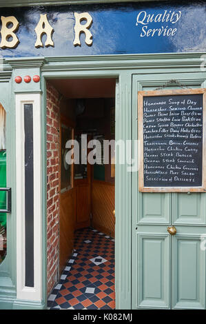 Chalk menu board outside the entrance doorway to a bar in Listowel, County Kerry, Ireland - Stock Image