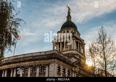 Sunburst over the Central Criminal Court, Old Bailey, London, UK - Stock Image