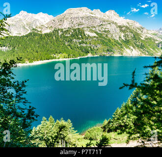 Codelago Lake in Devero Alp, scenic i talian landscape in a clear summer day with mountains and blue sky in background, Piedmont - Italy - Stock Image