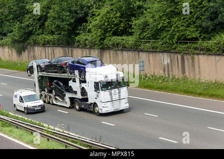 AIC Transport Ltd car transporter with Daf XF105 tractor unit travelling on the M61 motorway  near Farnworth, - Stock Image