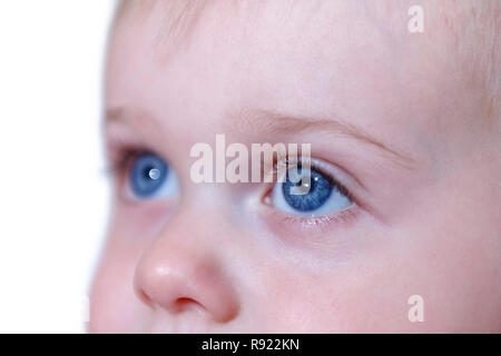 Beautiful young caucasian boy with very blue eyes looking away conceptually showing future, dreams or aspirations - Stock Image