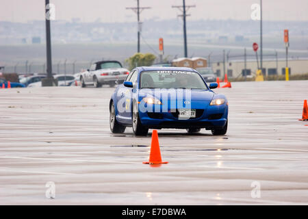 A 2005 Blue Mazda RX-8 in an autocross race at a regional Sports Car Club of America (SCCA) event - Stock Image