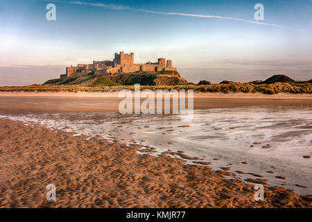 Bamburgh Castle is a castle on the northeast coast of England, by the village of Bamburgh in Northumberland. It - Stock Image