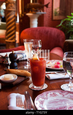 'Cocktail on set table in cocktail lounge of The Zetter Townhouse in London, England' - Stock Image