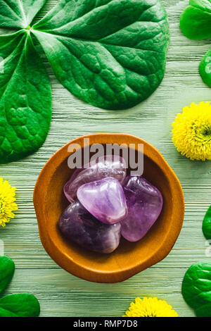 Amethyst with Shamrocks and Yellow Chrysanthemums - Stock Image