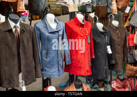 Mens and womens suede and leather coats jackets for sale in Florence,Tuscany,Italy - Stock Image