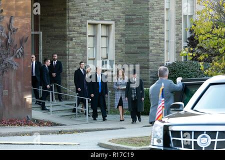 U.S President Donald Trump and first lady Melania Trump, walk with Rabbi Jeffrey Myers, right, followed by daughter Ivanka Trump and son-in-law Jared Kushner as they depart the Tree of Life Synagogue October 30, 2018 in Pittsburgh, Pennsylvania. - Stock Image