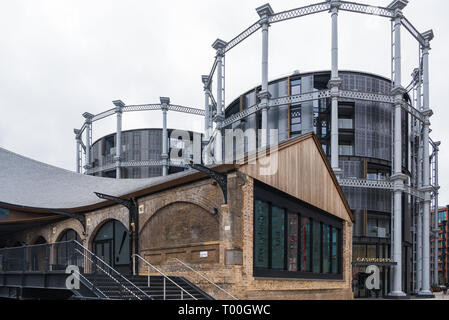 Gasholders, a development of residential apartments built within the cast iron frames of old gas holders, Coal Drops Yard, Kings Cross, London, UK - Stock Image