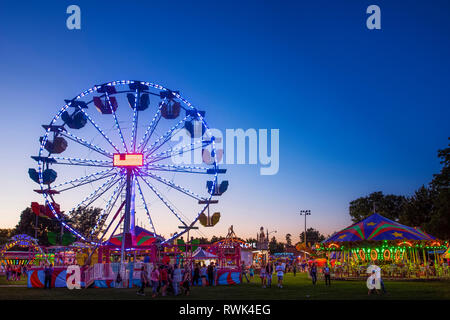 Ferris wheel at the fair on a summer evening; Ontario, Canada - Stock Image