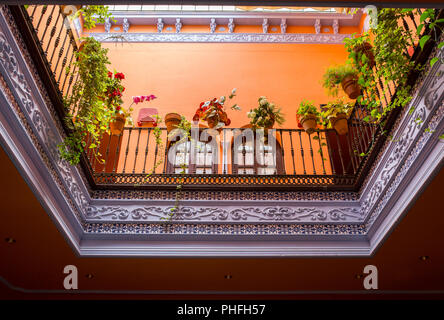 Andalusian style roofed courtyard, Seville, Spain. Upper floor - Stock Image
