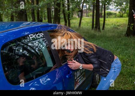 Bielsko-Biala, Poland. 12th Aug, 2017. International automotive trade fairs - MotoShow Bielsko-Biala. Woman's hair flying under the effect of car's bass. Credit: Lukasz Obermann/Alamy Live News - Stock Image