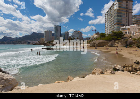 Calp Spain view of beach waves and seafront hotels and apartments on the Spanish Mediterranean coast - Stock Image