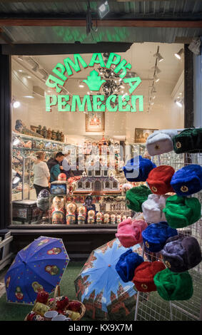 Shoppers looking round a tourist souvenir shop in Moscow city centre, Russia. - Stock Image