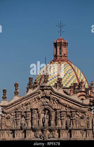 The tiled dome on the Baroque Churrigueresque style Iglesia del Carmen church and convent in the historic center on the Plaza del Carmen in the state capital of San Luis Potosi, Mexico. - Stock Image