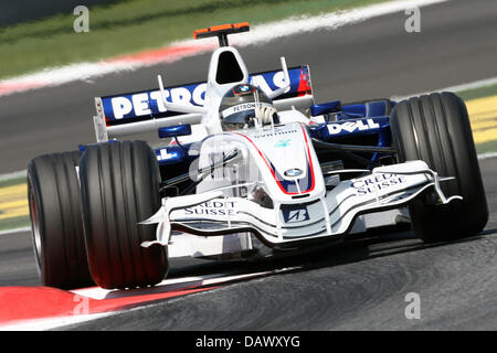 German Formula One pilot Nick Heidfeld of BMW Sauber steers his car celebrates in the qualifying session at the - Stock Image
