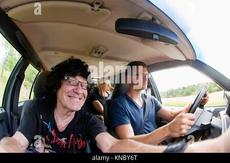 Father and son car selfie Stockholm, Sweden. - Stock Image