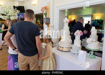 People shopping for wedding cakes at a Wedding Fair, Newmarket, Suffolk UK - Stock Image