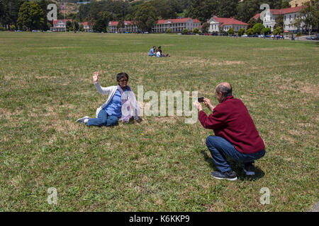 people, tourists, couple, taking photo, Cavallo Point Lodge, The Lodge at the Golden Gate, Fort Baker, city of Sausalito, Marin County, California - Stock Image